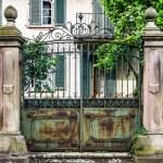 Old house gates with cast-iron lattice — Stock Photo #55867223