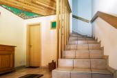 Wooden staircase in renovated house — Stock Photo