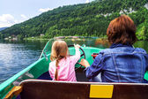 Little girl driving rental boat — Stock Photo