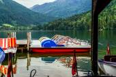 Pedal boats grouped together on the lake — Stock Photo