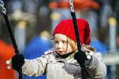 Cute little girl swinging on seesaw — Stock Photo