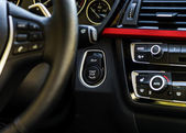 Start-stop button of luxury car dashboard — Stock Photo