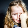 Crying blond little girl with focus on her tears — Stock Photo #61591067