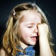 Crying blond little girl with focus on her tears — Stock Photo #61591069