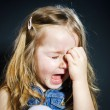 Crying blond little girl with focus on her tears — Stock Photo #61591083