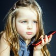 Cute little girl speaks using new cell phone. — Stock Photo #61591209