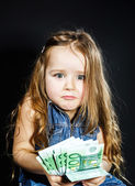 Cute little girl with money euro in her hand. — Stock Photo