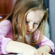 Cute little girl studing to speaking and writing letters at home — Stock Photo #62139893
