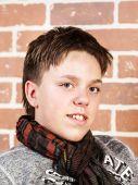 Affective teenage boy portrait in studio — Stock Photo