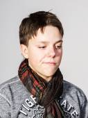 Affective teenage boy portrait in studio — Stock Photo