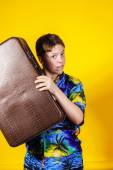 Affective teenage boy with retro suitcase — Stock Photo