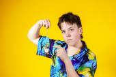 Affective teenage boy with watch showing time — Stock Photo