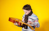 Affective teenage boy with guitar. Music concept. — Stock Photo