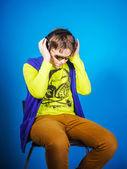 Affective teenage boy listening music in headphones — Stock Photo