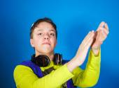 Affective teenage boy listening music in headphones — Stock Photo