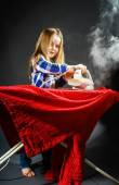 Cute little girl helping your mother by ironing clothes, contras — Stock Photo