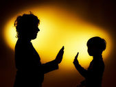 Two  expressive boy's silhouettes showing emotions using gesticu — Foto de Stock