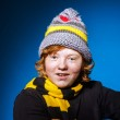 Expressive teenage boy dressed in colorful hat close-up portrait — Stock Photo #67135793