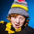 Expressive teenage boy dressed in colorful hat close-up portrait — Stock Photo #67135825