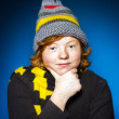 Expressive teenage boy dressed in colorful hat close-up portrait — Stock Photo #67135885