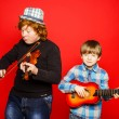 Two funny red-hair brothers playing music — Stock Photo #67189409