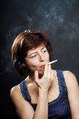Young woman smoking cigarette, healthcare concept — Stock Photo