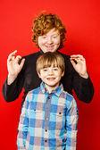 Two expressive brothers studio portrait — Stock Photo