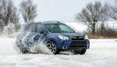 Powerful offroader car sliding by lake ice — Stock Photo