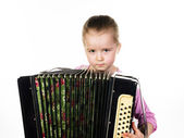 Cute little girl playing harmonica, music education concept — ストック写真