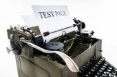 Old vintage typewriter with blank paper sheet — Stock Photo