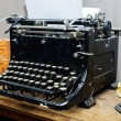 Old vintage typewriter with blank paper sheet — Stock Photo #71448145