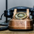 Old retro telephon on the table — Stock Photo #71900323