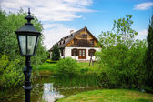 Countryside house with small lake in Poland — Stock Photo