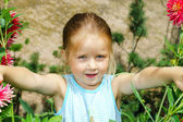 Cute preschooler girl portrait with natural flowers — Stock Photo