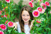 Teenage schoolgirl portrait with natural flowers — Stock Photo