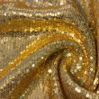 Fabric texture with reflective gold rings — Stock Photo #55072775