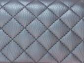 Texture dark leatherette sewn stitch a diamond — Stock Photo