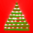 Glass and lightened Christmas tree — Stock Photo #57766303