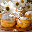 Cream puff or profiterole cakes — Stock Photo #57656505