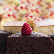 Chocolate cakes with fruits on a buffet table — Stock Photo #64201461