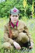 Girl in a red army uniform — Stock Photo