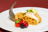 Slices of strudel with raisins and apples, selective focus — Stock Photo
