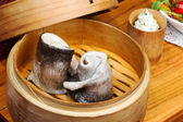 Tableware, wood cup with steamed fish — Stock Photo