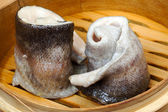 Tableware, wood cup with steamed fish. Creative cuisine. — Stock Photo