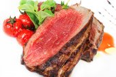 Medium Grilled bbq steaks and savory tomato sauce — Stock Photo