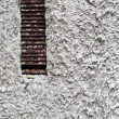 Rusty metal blinds in the window on an old rough wall. Great bac — Stock Photo #67816101