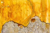 Abstract background concrete painted yellow paint, weathered wit — 图库照片
