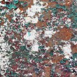 Abstract rusty metal surface with cracked paint green and burgun — Stock Photo #68280883
