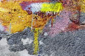 Abstract background concrete painted yellow and purple paint, we — Foto Stock