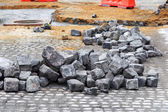 Pieces of rubble lying on the road, there is repair construction — Stock Photo